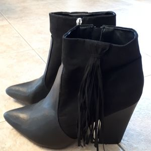Black tassel booties.